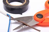image of electrical engineering  - Cable cutter electric wire and black insulating tape on white background accessories for engineer jobs and repair of electrical cable - JPG