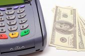 picture of terminator  - Payment terminal with money on white background credit card reader payment terminal with cash finance concept - JPG