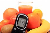 stock photo of immune  - Glucose meter fresh ripe natural fruits and glass of juice concept for diabetes healthy nutrition and strengthening immunity - JPG