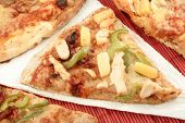 stock photo of doughy  - slices of pizza with different types of toppings - JPG