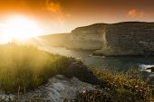 stock photo of gozo  - Xlendi Bay at sunset in Malta situated in the south west of the island of Gozo.