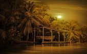 stock photo of pirate  - Sunset over old wooden pirate boat in caribbean bay - JPG