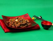 picture of stir fry  - Vietnamese beef stir fry served on a green background - JPG