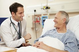 picture of hospital  - Doctor Sitting By Male Patient - JPG