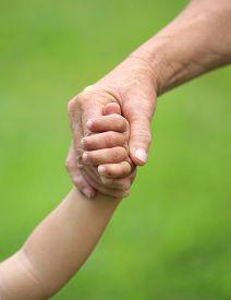 image of grandma  - Child and grandma holding hands closeup - JPG