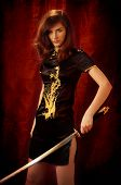 stock photo of bareback  - A woman dressed like a Giesha and Katana swords in her hands - JPG