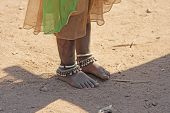 India, Hampi, 02 February 2018. The Feet Of A Small Indian Girl In Silver Bracelets And Ornaments. O poster