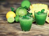 Healthy Green Smoothie, Refreshing And Healthy Drink - Green Smoothie Made With Fresh Organic Fruit poster