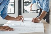 Hands Of Architect Or Engineer Working On Blueprint Meeting For Project Working With Partner On Mode poster