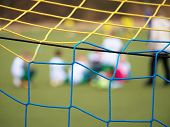Football Training.  Crossed Soccer Nets Soccer Football In Goal Net With Grass On Outdoor Playground poster