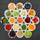 Brain boosting health food in porcelain bowls on slate background. Healthy food concept with foods h poster