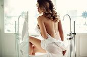 Beautiful Sexy Lady In Elegant White Shirt In A Bathroom. Fashion Portrait Of Model On A Bath Indoor poster