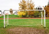 Old Vacant Football Soccer Goal Gate In Rural Grass Field. poster
