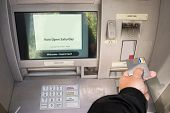 Person accessing Automatic Teller Machine