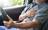 Asian Senior Man Having Chest Pain From Heart Attack While Driving A Car.  Illness, Exhausted, Disea poster