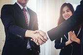 Business Hand Shake Deal Success With Woman Clapping poster