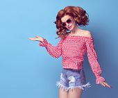Fashion Pretty Pinup Redhead Girl Smiling Having Fun. Presenting Your Product. Trendy Curly Hairstyl poster