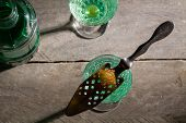 Burned Sugar On Spoon, Traditional Method Served Of Absinthe. poster