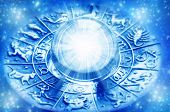 zodiac with astrological symbols and crystal ball with light