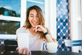 Attractive Beautiful Happy Young Asian Woman Taking A Selfie Using A Smart Phone At Cafe. Young Asia poster