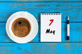 May 7th. Day 7 Of May Month, Calendar Written On Morning Coffee Cup At Blue Wooden Table, Top View.  poster