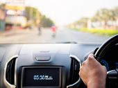 Man's Hands Holding Steering Wheel And Blur Road Background. Driving Concept poster