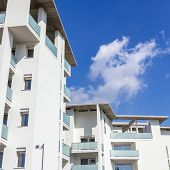 Modern Apartment Buildings On A Sunny Day With A Blue Sky. Facade Of A Modern Apartment Building. poster