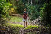 Traveler Woman With Backpack Walking On Path In The Tropical Forest, Travel In Thailand, Summer Holi poster