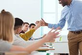 Cropped Image Of African American Taking High Five To Multicultural High School Teenage Students poster