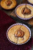 Small Cakes Gluten And Sugar Free With A Whole Pear On Top poster