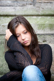 stock photo of teenage girl  - Outdoor portrait of a sad teenage girl looking thoughtful about troubles - JPG
