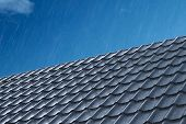 Rain Pours On The Metal Roof Tiles Of The House. Rain On The Roof. Modern Roof Made Of Metal. Corrug poster