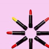 Set Of Yellow With Red Lipstick Isolated Equalled A Circle On Pink Color Background. Colorful Tones, poster