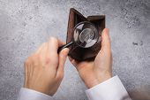 Russian Ruble In A Wallet. A Man Is Looking For Money In A Wallet With A Magnifying Glass. The Conce poster