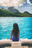 Luxury travel boat trip excursion woman tourist relaxing on idyllic blue lagoon cruise vacation trav poster