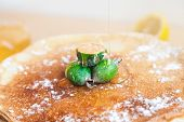 A Thin Stream Of Honey Flows On The Feijoa Fruits Decorating Thin Pancakes poster