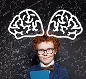Young Boy Genius And Brain Power. Happy Redhead Kid Against Chalkboard poster
