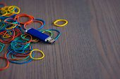 Close Up Shot Of Multi Colored Rubber Bands, Blue Usb Flash Drive, Flash Card poster
