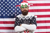 Santa Is Watching You. Bearded Man Wear Funny Glasses. Funny Hipster On American Flag Background. Fu poster
