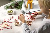 Cute Boy Make The Craft. The Child Makes A Christmas Tree Decoration, Holds Scissors And Cuts The Ri poster