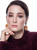 Close Up Portrait Of A Confident Pretty Young Woman With Neutral Brown Smoky Eyes Makeup And Glowing poster