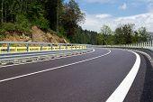 stock photo of twisty  - An Asphalt twisty mountain road in hills - JPG