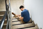 Man Sitting On Staircase After Slip And Fall Accident poster