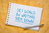 set goals by writing them down reminder - handwriting in a spiral sketchbook, planning, setting and  poster