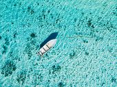 White Boat In Blue Ocean In Paradise Island. Aerial View. poster