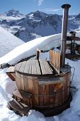 foto of hot-tub  - wooden hot tub in the alps with mountains behind - JPG