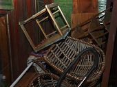 Stack Of Old Wicker Chairs And Unwanted Household Stuff, Outdoor Night Scene poster