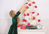 Child Hang Christmas Ornament Ball On Artificial Tree. Kids Can Brighten Up Christmas Tree By Creati poster