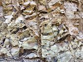 Surface Of Rocks Wall. Sheer Wall Of The Mountain. Rock Background. Layering Of Rocks. Stone Backgro poster