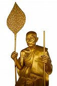 Golden Buddhist Monk With A Staff And A Fan Isolated On A White Background. Buddhist Old Man In Thai poster